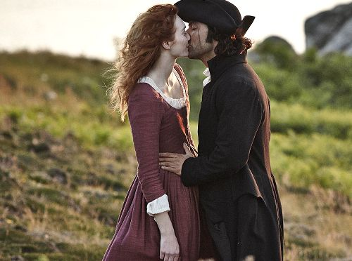 Demelza and Ross Poldark from the series 'Poldark' kiss.