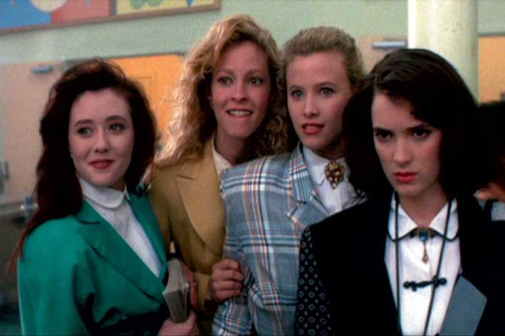 A still from the film 'Heathers'. Four high school girls stare into space.