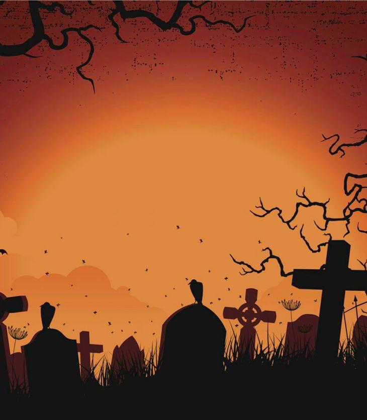 Cartoon graveyard, featuring graves and creepy black trees