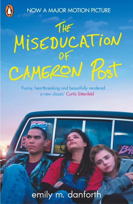 Book cover of The Miseducation of Cameron Post, featuring three teens sitting on the back of a car