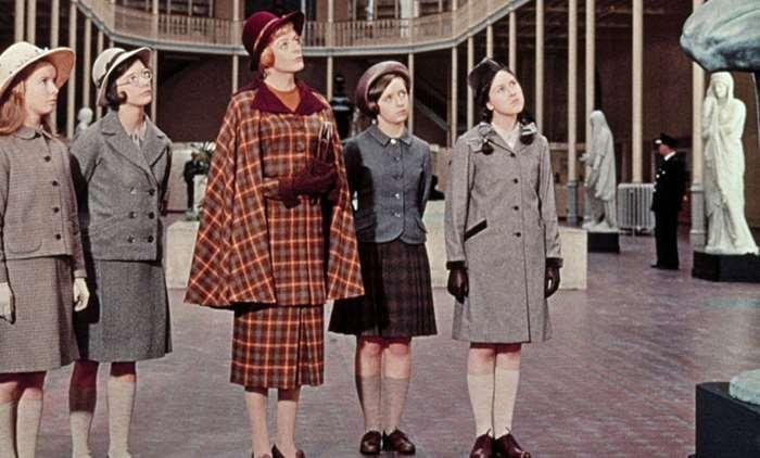 School girls stand with their teacher, Miss Brodie