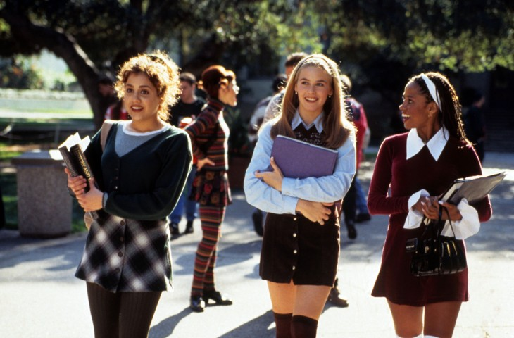 The main girls in the film 'Clueless' walk near their school carrying their books and bags.