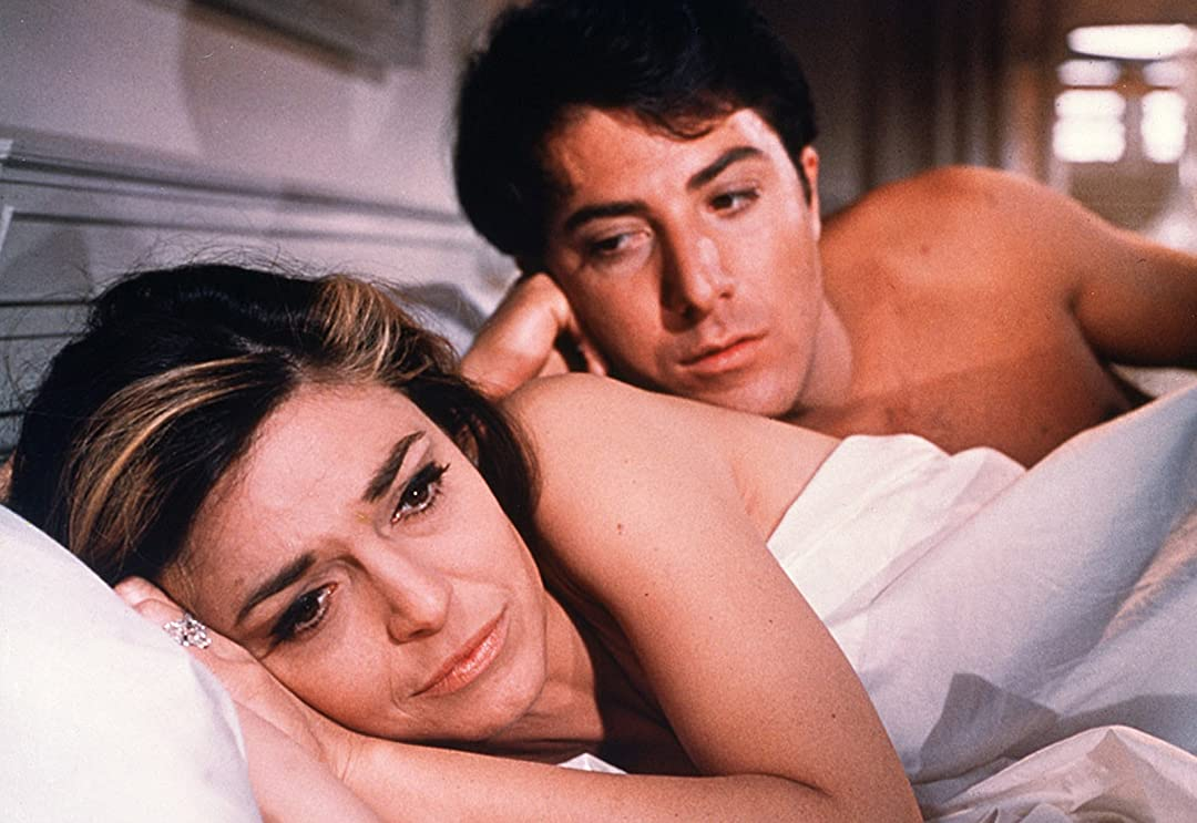 Still from 'The Graduate'. The main characters (lovers) lay in bed together.