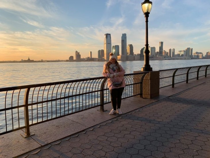Woman poses on a bridge in New York
