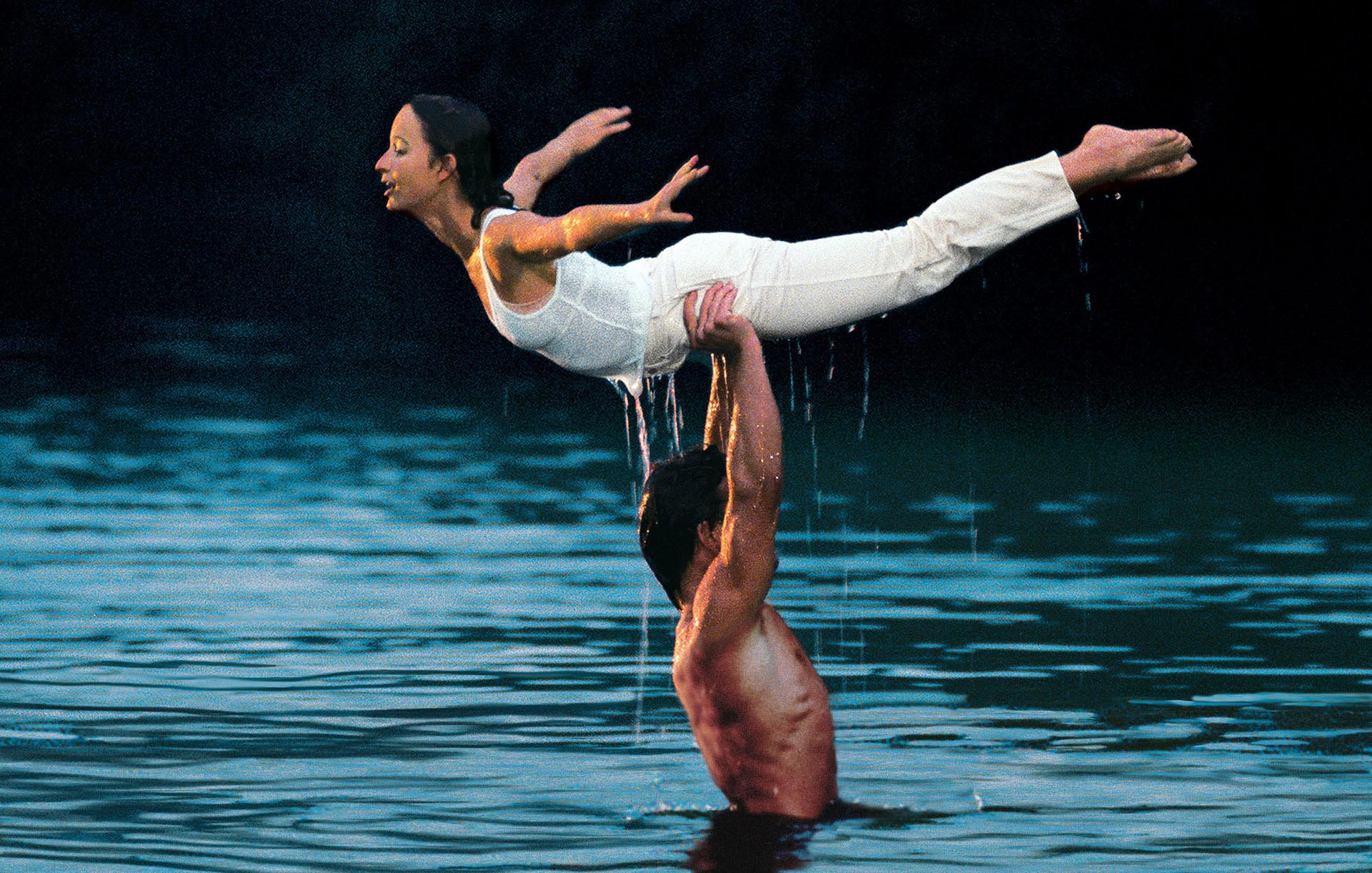 Patrick Swayze and Jennifer Grey practice the classic lift in the water.