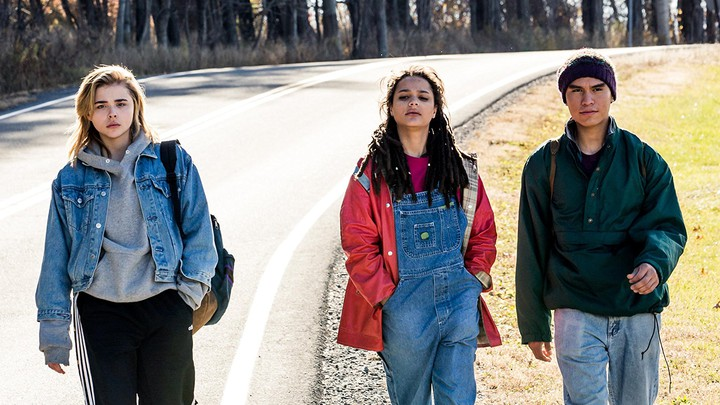 Three characters from The Miseducation of Cameron Post walk in the street in a still from the film