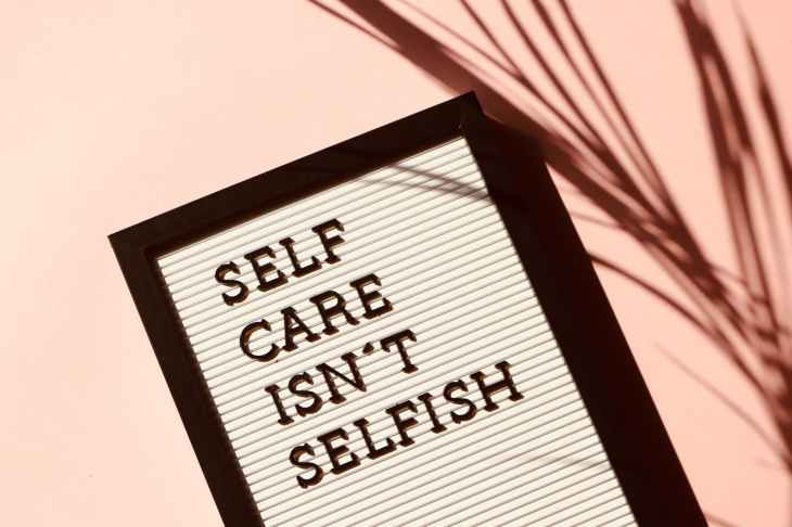 "A poster that says ""self care isn't selfish""."