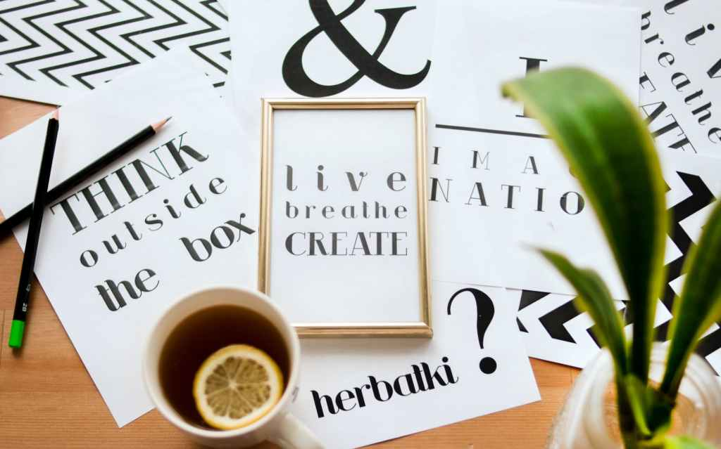 """A mixture of motivational quotations and posters, such as """"Live Breathe Create""""."""