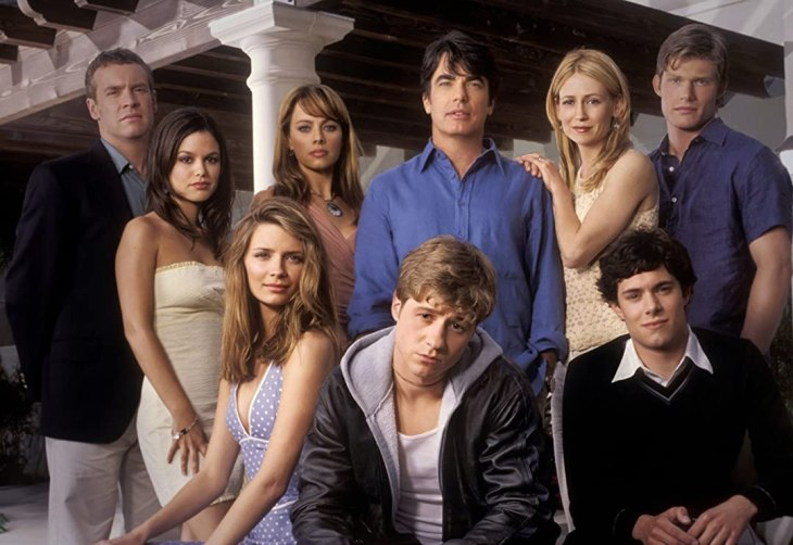 The characters of 'The O.C.' pose and stare at the camera.