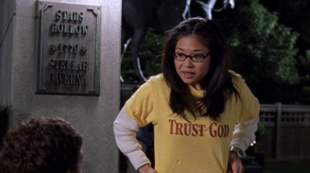 "Lane Kim from 'Gilmore Girls' wears a t-shirt that reads ""Trust God""."