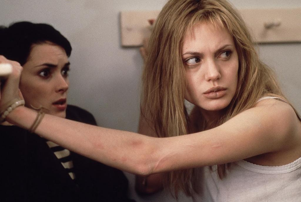 A still from 'Girl Interrupted' featuring Winona Ryder, who looks terrified by another hospital inmate.