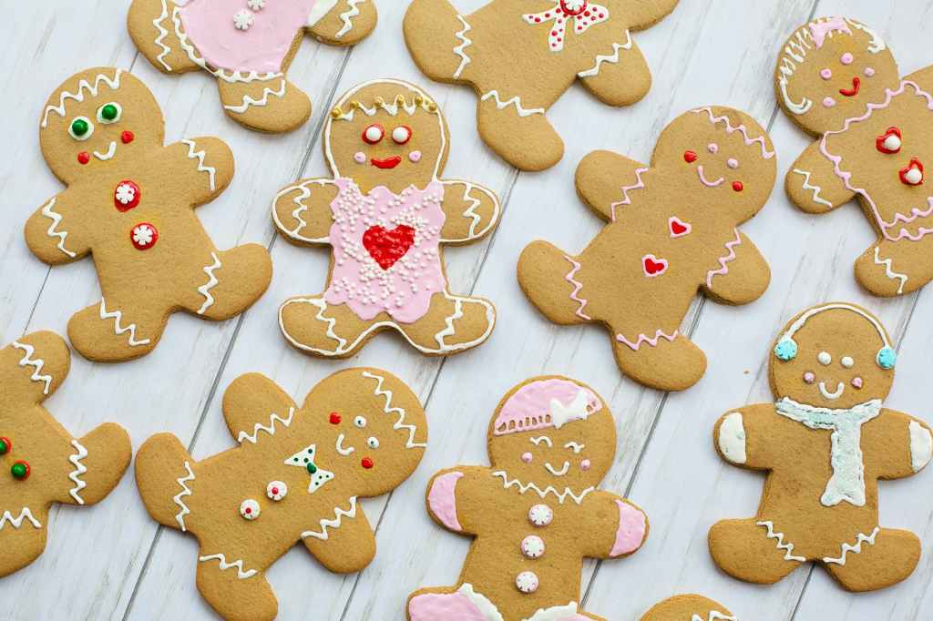 Christmas gingerbread men and women with pink icing