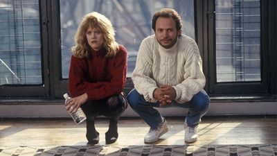 The two characters of 'When Harry Met Sally' sit and stare at the camera.
