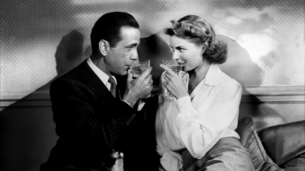 The two characters from 'Casablanca' drink and stare into each other's eyes.