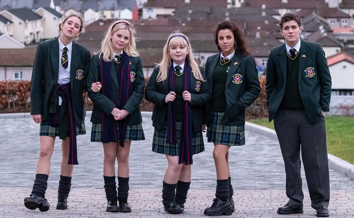 Image from Derry Girls series, school children stand and pose for the camera