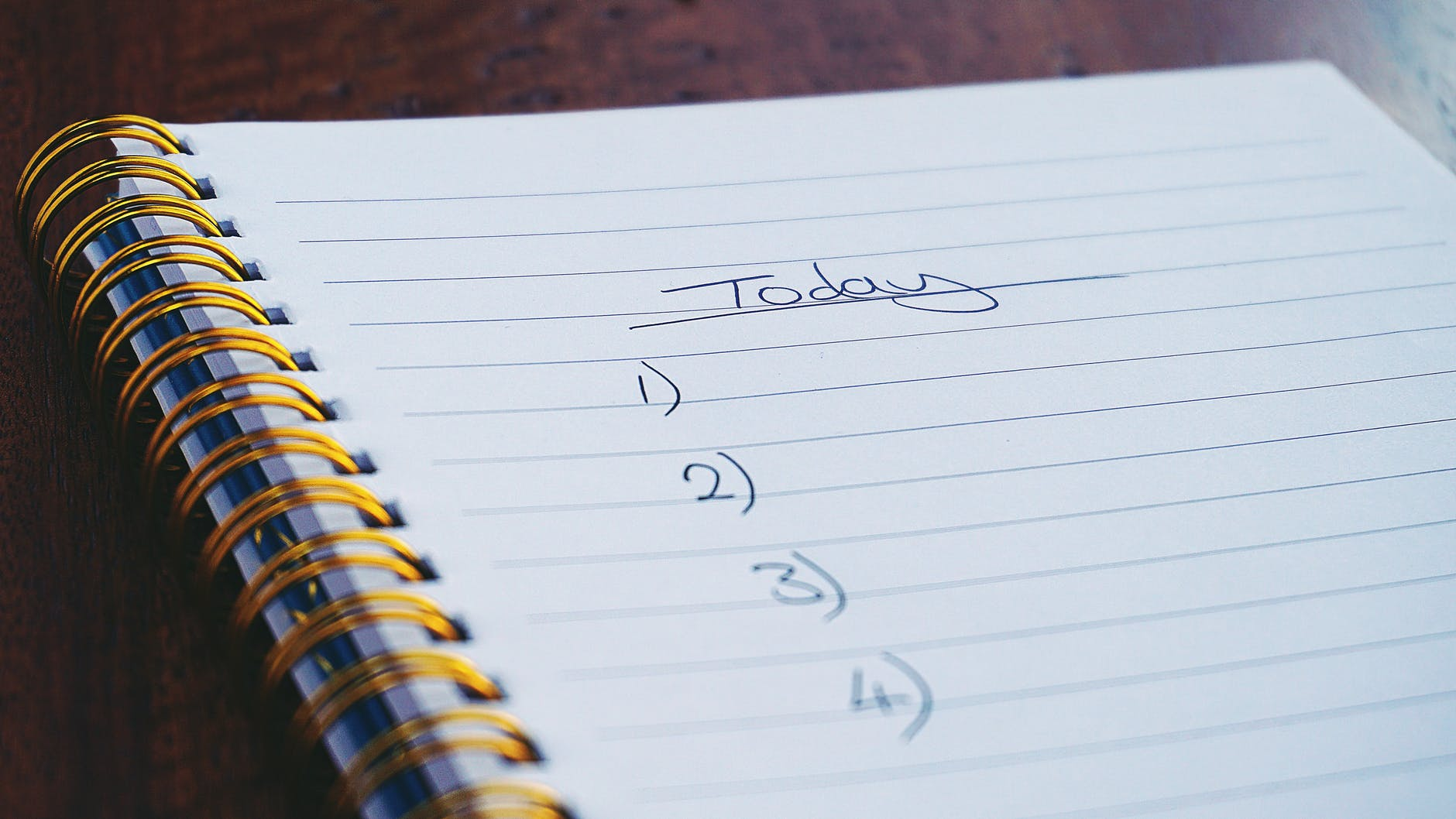 """A notebook is open on a page reading """"Today..."""" and a list of numbers."""