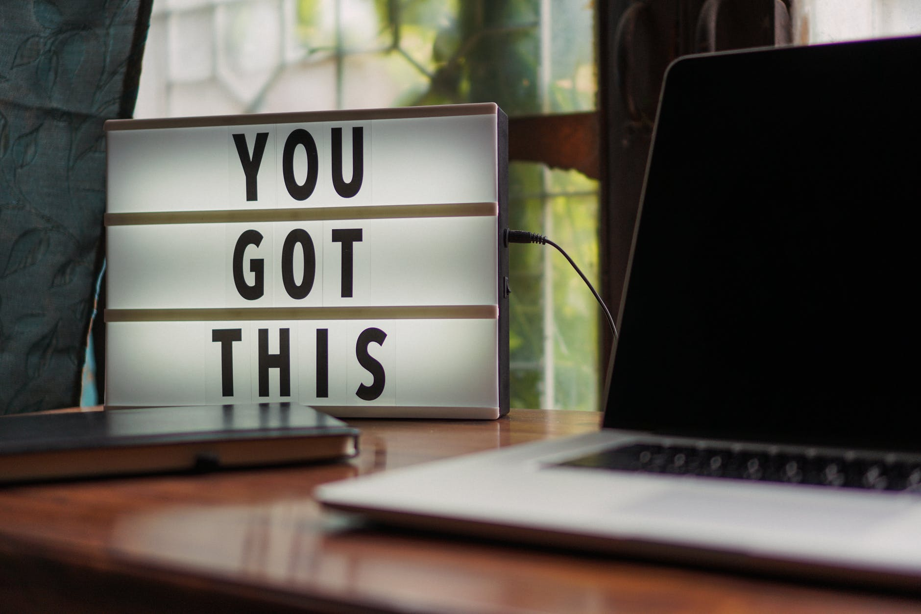"Laptop and sign that reads ""You Got This"""