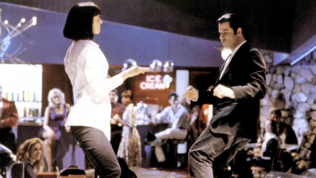 The two characters from 'Pulp Fiction' dance in a bar while people watch.