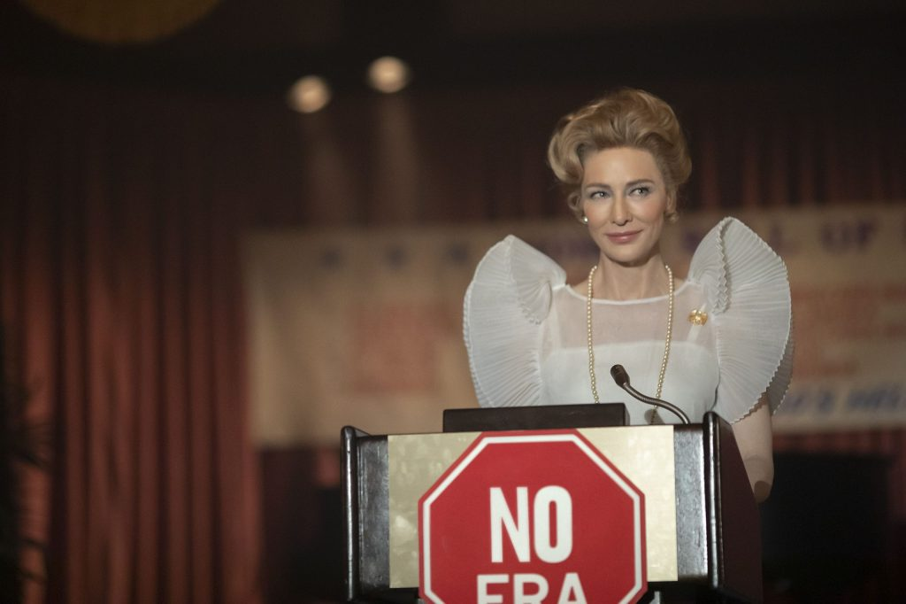 Phyllis Schlafly, the head of the Stop E.R.A. Movement stands on a stage and tries to make her audience think about why the E.R.A. is bad.