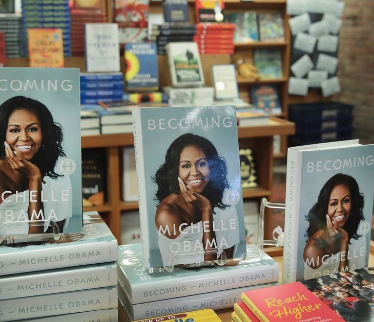 Becoming by Michelle Obama on a stand for sale