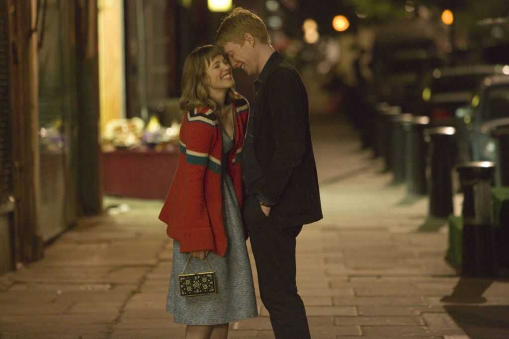 The two main characters of the film 'About Time' kiss.