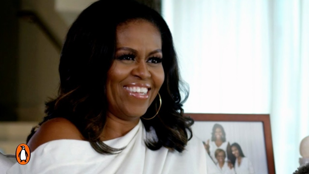 Michelle Obama smiles for the camera in what looks like a half-candid shot.