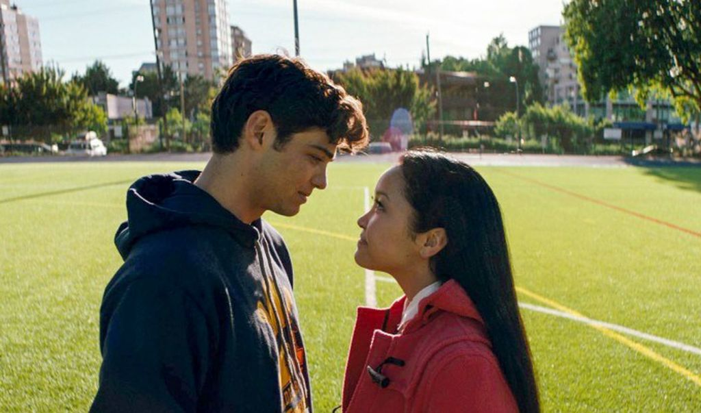 The two main characters of the film 'To All the Boys I've Loved Before' stare into one another's eyes.
