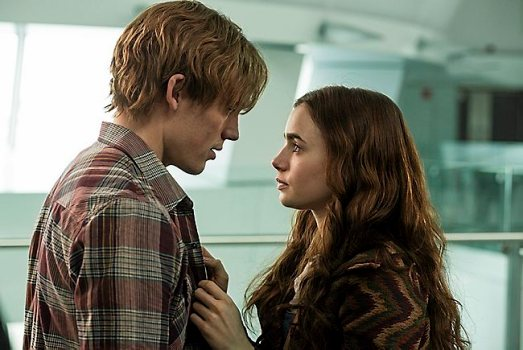The two main characters from the film 'Love Rosie' have a loving moment at the airport.
