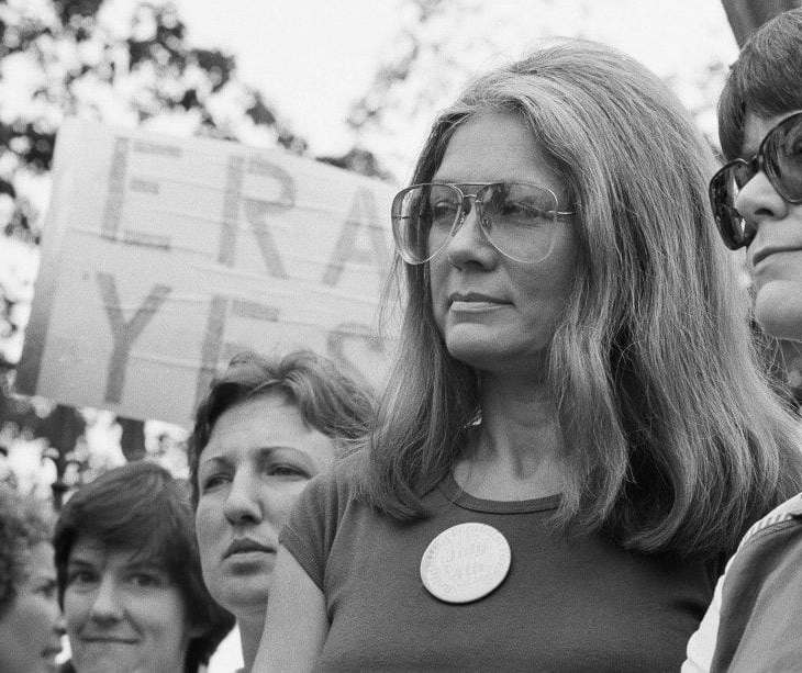 Activist Gloria Steinem is at a pro-ERA rally with other women