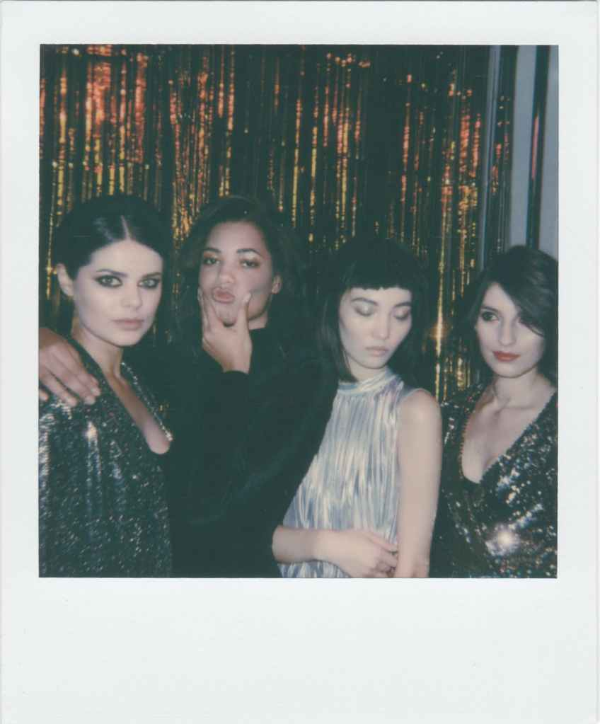 A Polaroid style photo of four young girls.