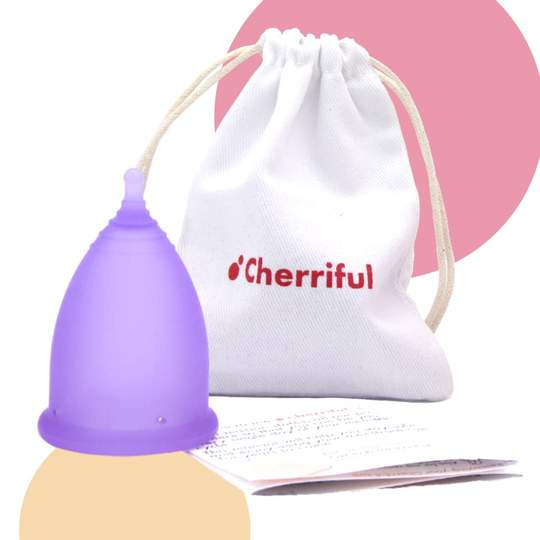 Cherriful period cup next to a cloth storing bag and information leaflet