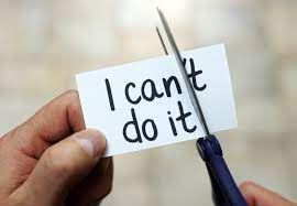 """Cutting a piece of paper that says """"I can't do it"""" so that it says """"I can do it""""."""