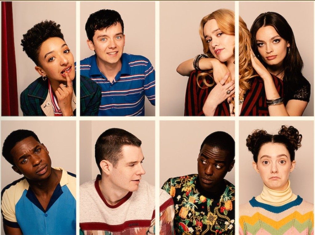 The characters of 'Sex Education' series 3 pretend to take photos together. They make funny faces at the camera and include 4 girls and 4 boys.